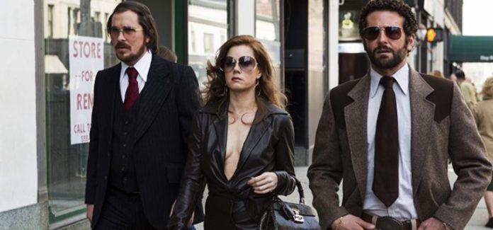 Christian Bale, Amy Adams, and Bradley Cooper in American Hustle 2013